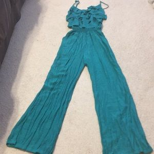 NWT! Turquoise jumpsuit with ruffled top.